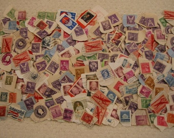 vintage cancelled postage stamps from the 1930's - 1970's  . . .  very good vintage condition . . U.S.A., Canada, Norway, Equador, WWII era