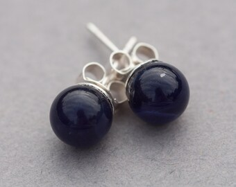 Sodalite stud earrings on sterling silver posts.