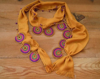ochre yellow scarf with multicolored crochet circles, mustard