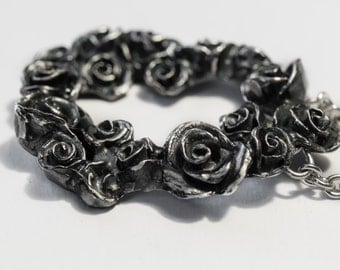 silver roses pendant on a cable chain