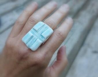 """Porcelain ring """"Positivity"""" Aqua crackled glaze with adjustable band."""