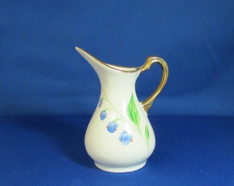 Modernist Style Pitcher Shaped Blue Floral Vase, Off white with blue flowers and green leaves, appears hand painted