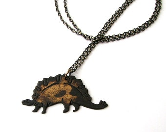 blackened stegosaurus necklace . rustic dinosaur necklace on long chain . womens mens necklace