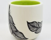 Porcelain Wheel Thrown Cup with Black and White Hand Painted Feather and Chartreuse Inside