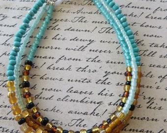 Triple Strand Shades Of Aqua And Brown Seed Bead Bracelet