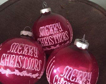 Vintage ornaments that read Merry Christmas