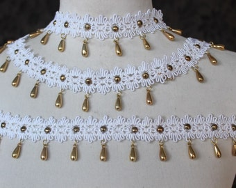 Very nice embroidered  white  trim  with  hanging gold color  beats  1 yard listing