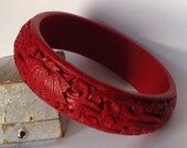 Vintage wide chunky red cinnabar style bracelet or bangle with carved lotus flower detail