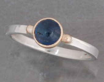 Cabochon sapphire ring in sterling silver and 14 karat gold