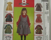 UNCUT McCalls Pattern 2989 Easy to Sew Girls Dress with Full Gathered Skirt & Pinafore Sizes 2-3-4