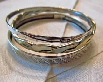 Three vintage sterling silver thin bangle bracelets