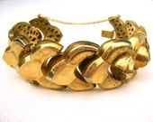 Bracelet with safety chain, Art Deco hollow sculpted links, high fashion jewelry, vintage patina may be gold plate on tarnished silver metal