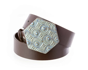Hexagonal pottery belt buckle in subtle sky blue with op art texture. Buckle only. Belt sold separately.