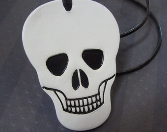 Grinning Skeleton Halloween Ceramic Ornament or Decoration