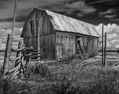 Old Wooden Barn in Black and White by a Corral Fence out West under a Cloudy Blue Sky No.BW6672 - A Fine Art Farm Ranch Landscape Photograph