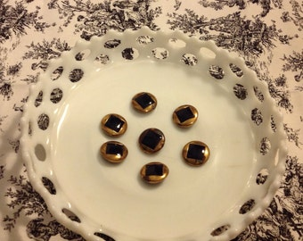Gold and black buttons