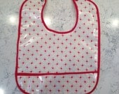 Retro-style red and white bib with red trim