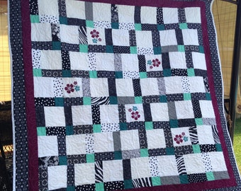 REDUCED 20% Beautiful black, white, teal lap qilt, throw with added hibiscus embroidered flowers,