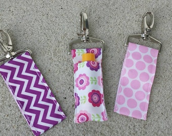 Purple and pink lip balm holders