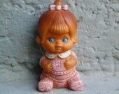 Vintage squeak toy doll