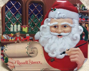 Vintage RUSSELL STOVER Santa Tin Container Blue Red Christmas Hinged Lid Advertising