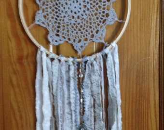 Gray Skies dream catcher-gray doily accented with gray and white fabric,silver beads, and lace nestled in a wooden embroidery hoop,