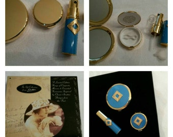 Stratton Compact Gift Set Featuring A Raised Gold Tone Art Deco Design On An Aquamarine Celluloid Background Circa 1950's-1980's    DR224