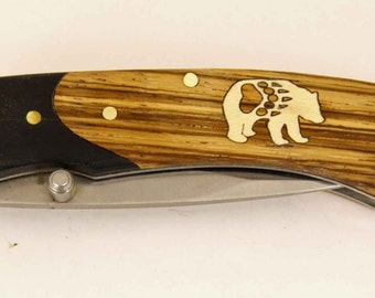 Rough Rider knife with Zebra wood handle and Custom maple bear with paw inlay