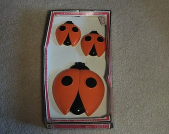 Set of 3 Ladybug  Miller Wall Plaques in the original box, 3 Orange and Black Lady Bugs Chalkware Hand Painted
