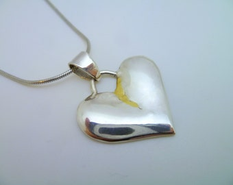 Broken Heart Pendant in Gold and Silver