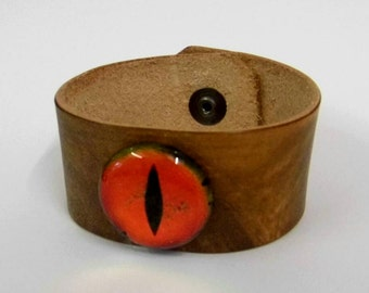 Red, fire dragon eye on leather wrist band