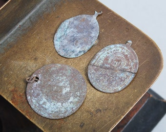 Set of 3 Antique plates, parts of religious brass charm, medal, cross