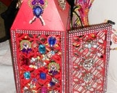 Bejeweled lantern gobs of rhinestones on a red lantern hand jeweled Hollywood regency style