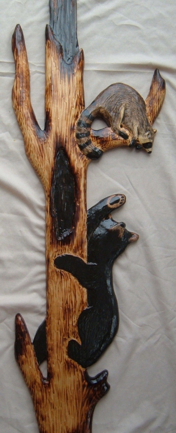 Black bear raccoon wood carving chainsaw log cabin decor