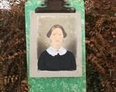 A Vintage Clip Board That Displays Art Amazingly