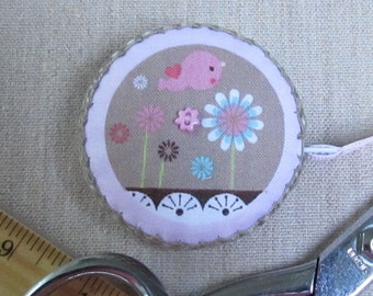 Retractable tape measure, covered with whimsical garden fabric
