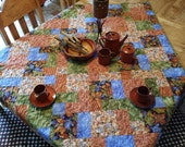 FALL Autumn colors table topper, lap quilt, wall hanging, bed topper. Gorgeous Persimmon, navy, periwinkle leaves fabric. Botanical.