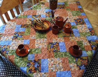 Table topper, tablecloth, lap quilt, wall hanging, bed topper.  Sumptous fall autumn colors will make a stunning table. quiltsy handmade