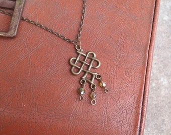Antique brass Celtic knot charm with olive green beads