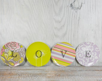 Decorative wall plates spell out the word LOVE, wall hanging, wall display, wall plate decor, wall art