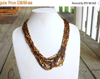 MOVING SALE Half Off Pretty Vintage Signed Hobe Shades of Autumn Amber and Brown Tube Glass Seed Bead Necklace
