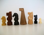 instant collection of 7 different chess horse game pieces . chess pieces . knight chess pieces . knights
