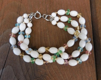 Vintage 1950s to 1960s White Glass Beaded Bracelet With Blue and Pink Beads In Between Silver Tone Triple Strand Multi