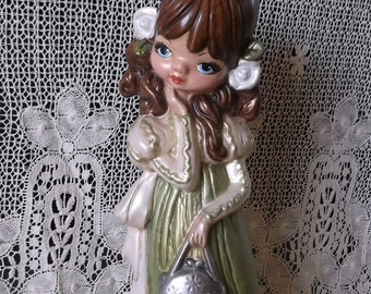 Vintage 1970s kitsch girl, big eyes, doll statue, green and cream