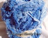 Fancy Yarn. Bumpy design, multicolor shades of blue and glitter threads. Yarn Panda.