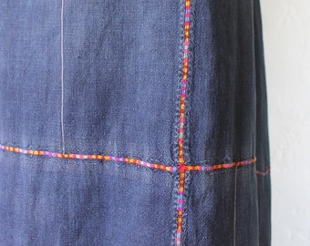 long indigo-dyed skirt