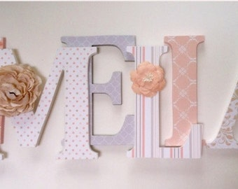 Wooden  letters for nursery in peach , tan, gray and white.