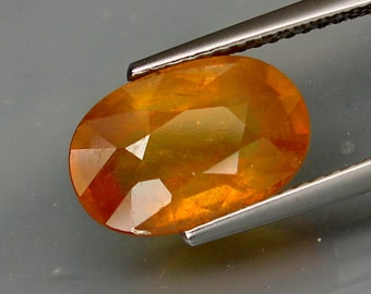 Glowing Opaline Orangeish Yellow Sapphire Faceted Oval, 12 x 8 MM, 5.73 Carat, Looks Like Yellow Opal, Pukhraj