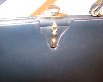 International Creations navy leather handbag