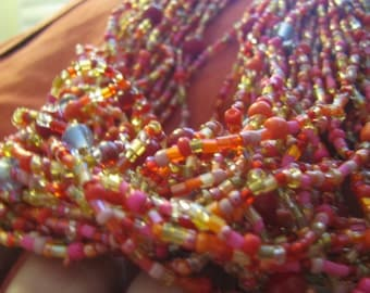 "Glass beaded necklace red pink green signed ""T"" highest quality from 1970s."